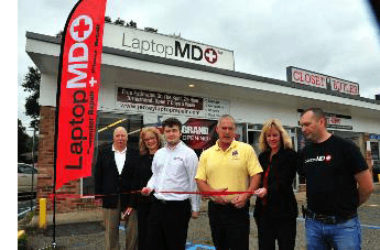 Pequannock officials cut ribbon at Laptop MD